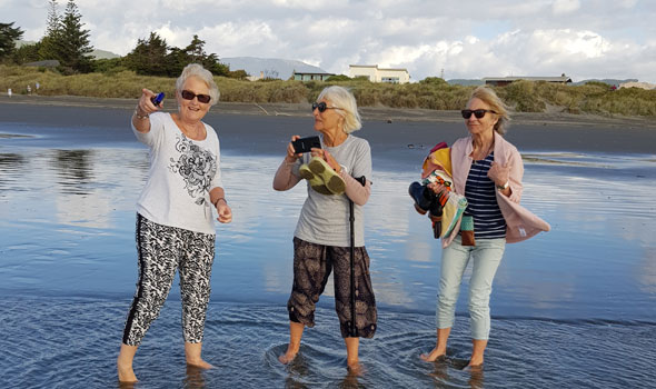 What is AgeConnect. Three ladies on Kapiti beach.